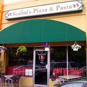 Scalini's has Outdoor Seating. 2 tables.