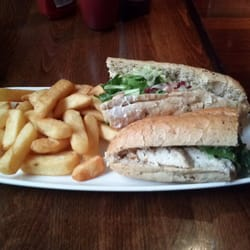 Chicken and bacon sandwich and chips