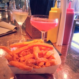 Champagne, sweet potato fries and a cranberry/tequila creation