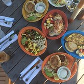 Estia's Little Kitchen - Sag Harbor, NY, United States. Delightfully colorful dishes and great food as well! Crab n' eggs on the lower right corner orange plate with avocado and toast.