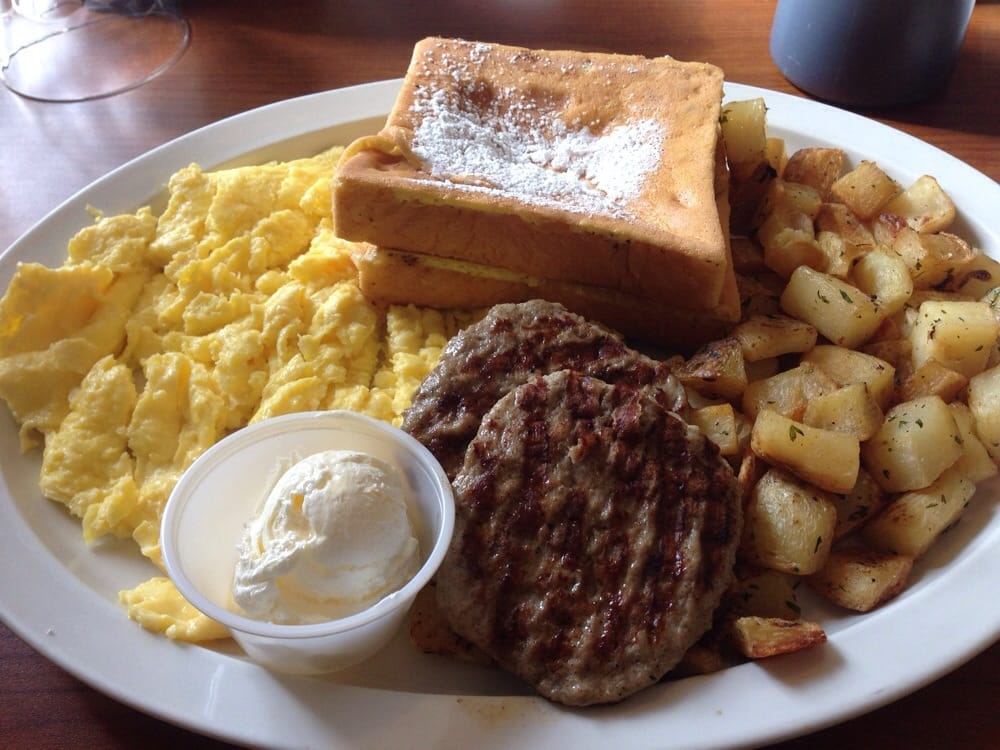 French toast with scrambled eggs, potatoes, and turkey ...
