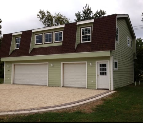 A gambrel roof garage apartment constructed from Structural insulated panels texas