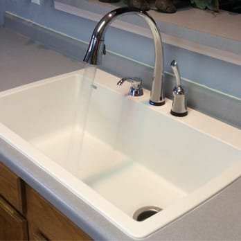 replacing my old kitchen sink with a new kitchen sink and faucet love