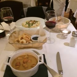 seafood soup, calamari with ink aioli,…