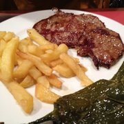 Grilled Veal Steak with fries and grilled poblano