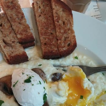 ... Killer dish. Poached eggs over gruyere grits and sautéed mushrooms