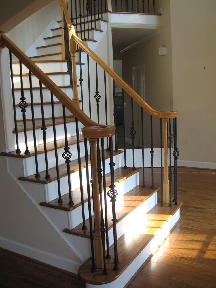New Hardwood Staircase And Wrought Iron Balusters