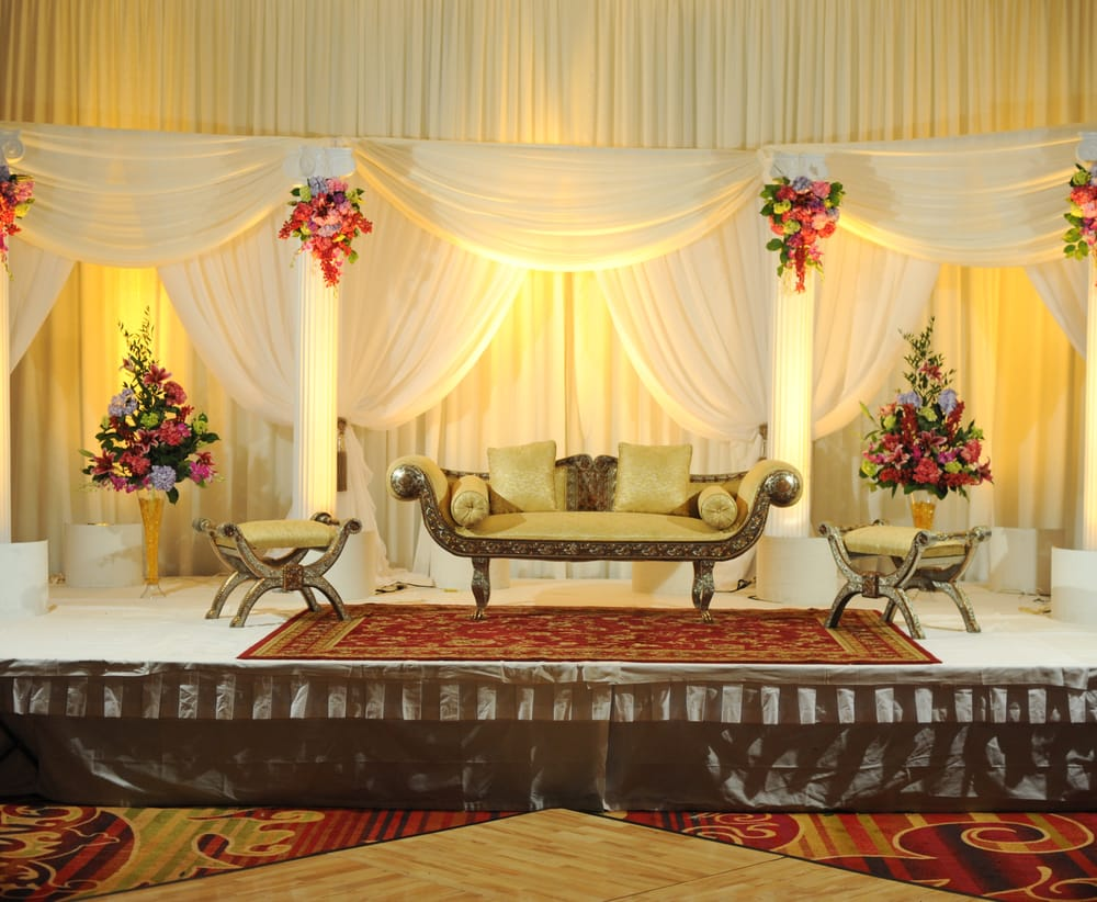 Wedding Stage Decoration With Flowers Decorated On The Columns