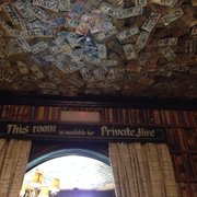 Money signed and stuck to the ceiling in…