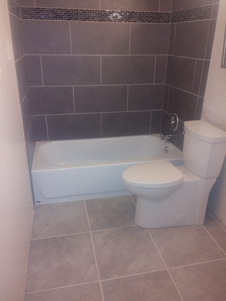 12x24 grey porcelain on subway lay with 4inch glass liner for Bathroom 12x24 tile