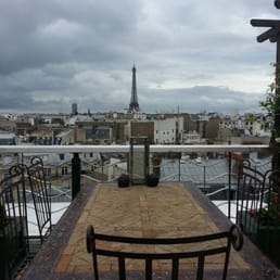 Outdoor terrace with view of the eiffel tower