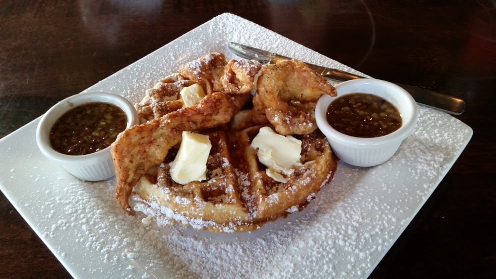 Outlaw beer battered chicken on a sweet cream Waffle with pecan syrup ...