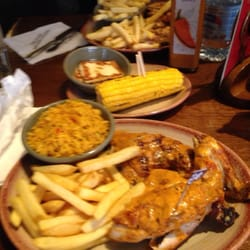 Half hot chicken, chips, spicy rice and…