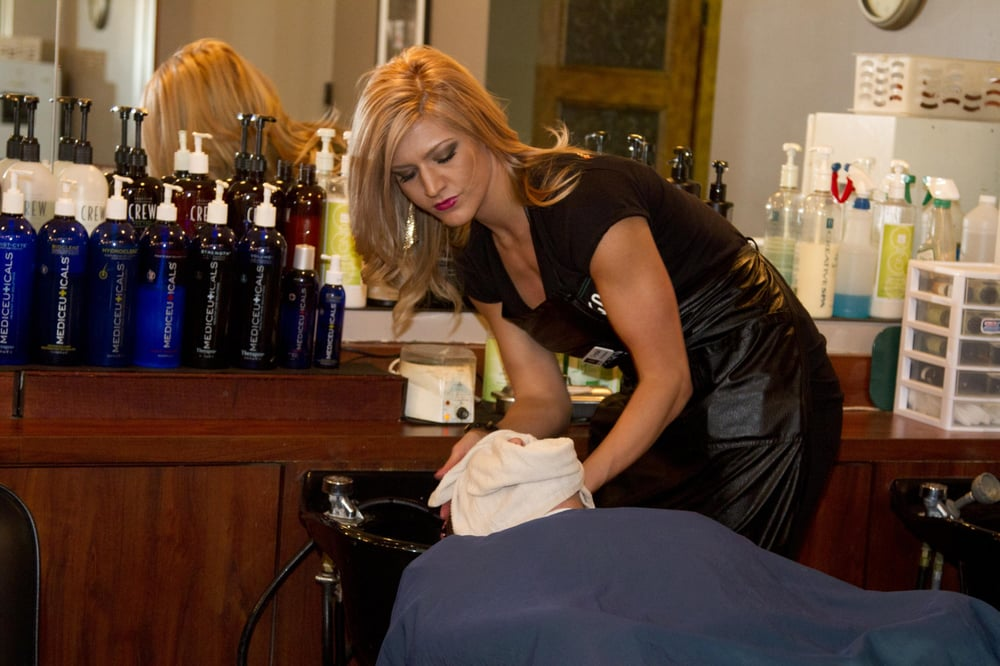GQ Barber Lounge - Crystal shampoos one of her clients before his ...
