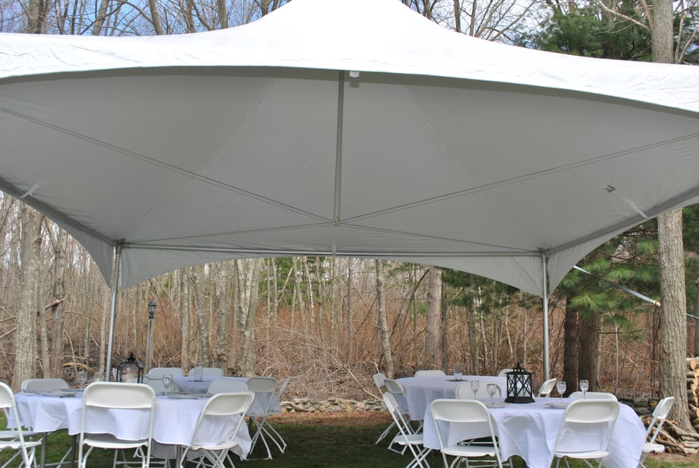20x20 tent with tables chairs and linens yelp
