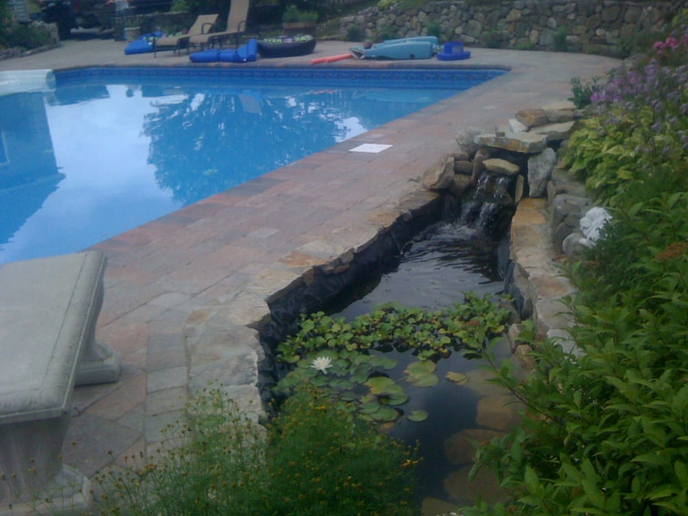 Pool area pavers coping fieldstone walls koi pond for Koi pond pool