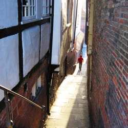 Small stepped alleyway with mediaeval houses between Quarry Street and Millbrook