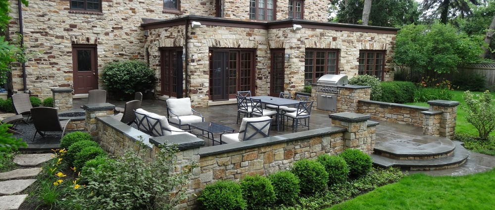 A raised natural stone terrace with sunken fire pit circle for Terrace nature