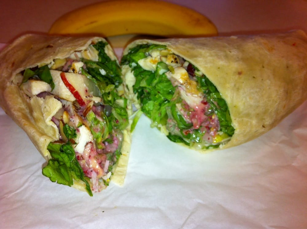 Special dried cranberry grilled chicken wrap has apples, red onion ...