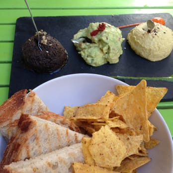 Three HUGE scoops of hummus, guacamole and tapenade.  Delicious!