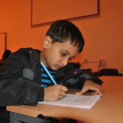 A student completing his English tuition at the Solihull Tudor Grange Kumon Tuition Centre