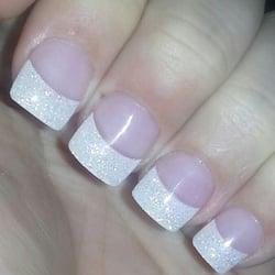 Pink and White Nails logo