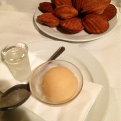 Madeleines and an apple sorbet (served…
