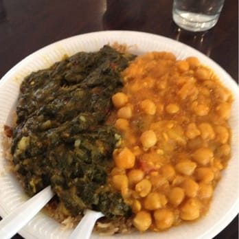 A picture of half spinach and potato curry, half chickpea masala. 2 veggie curries for £4.50--and yes, there's always this much!