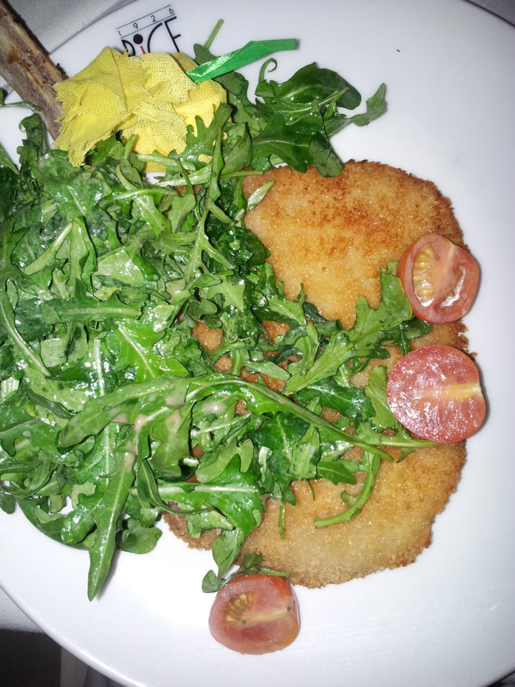 ... Ristorante Veal Chop Milanese Style Pounded Topped With Arugula Salad