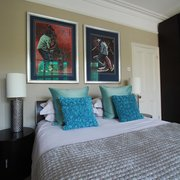 Aqua and silver shades in a bedroom add…