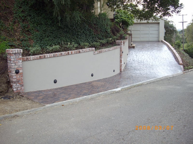 New Concrete Retaining Wall With Brick Columns The New