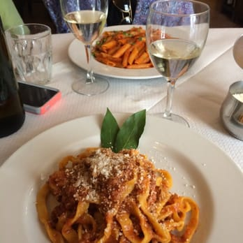 The bolognese in the front, delicious house wine in the middle, and penne arrabbiata in the back