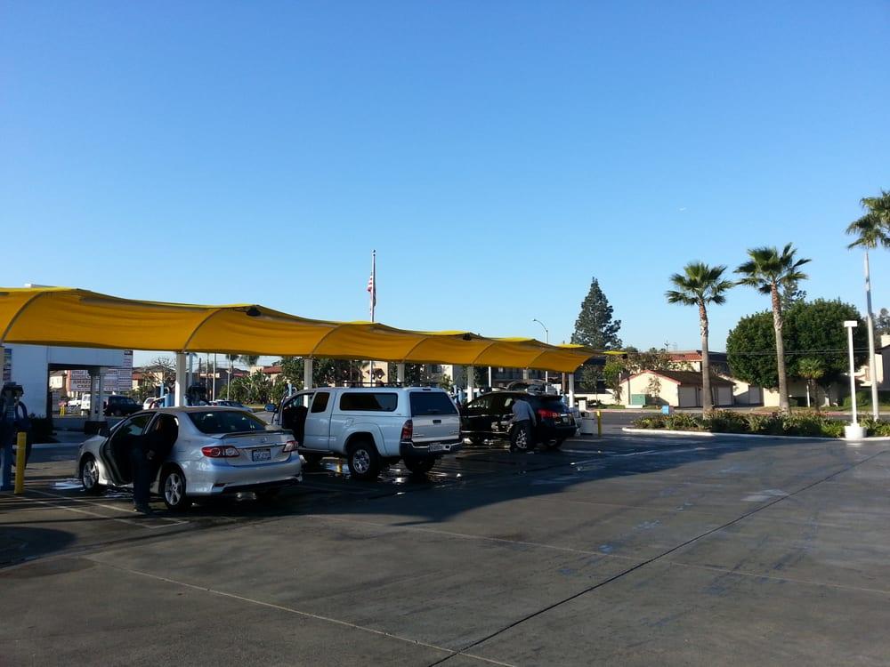 Photos for drive thru express car wash yelp for Express wash roma