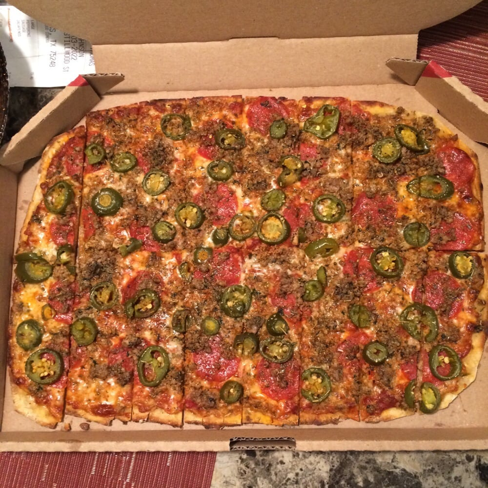 large pizza with pepperoni italian sausage and jalape os