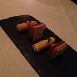 Amuse bouche of foie gras and a chèvre cannelloni.