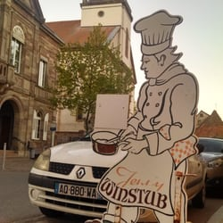 A baker greets you outside the…
