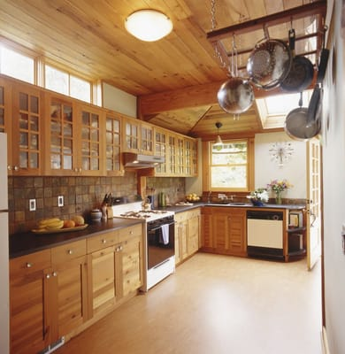 Custom reclaimed wood cabinets gives this green kitchen remodel tons