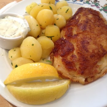Potatoes with fried fish.