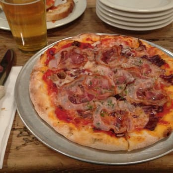 Rustic pizza (pancetta, prosciutto, & radicchio) and a pint of spotted ...