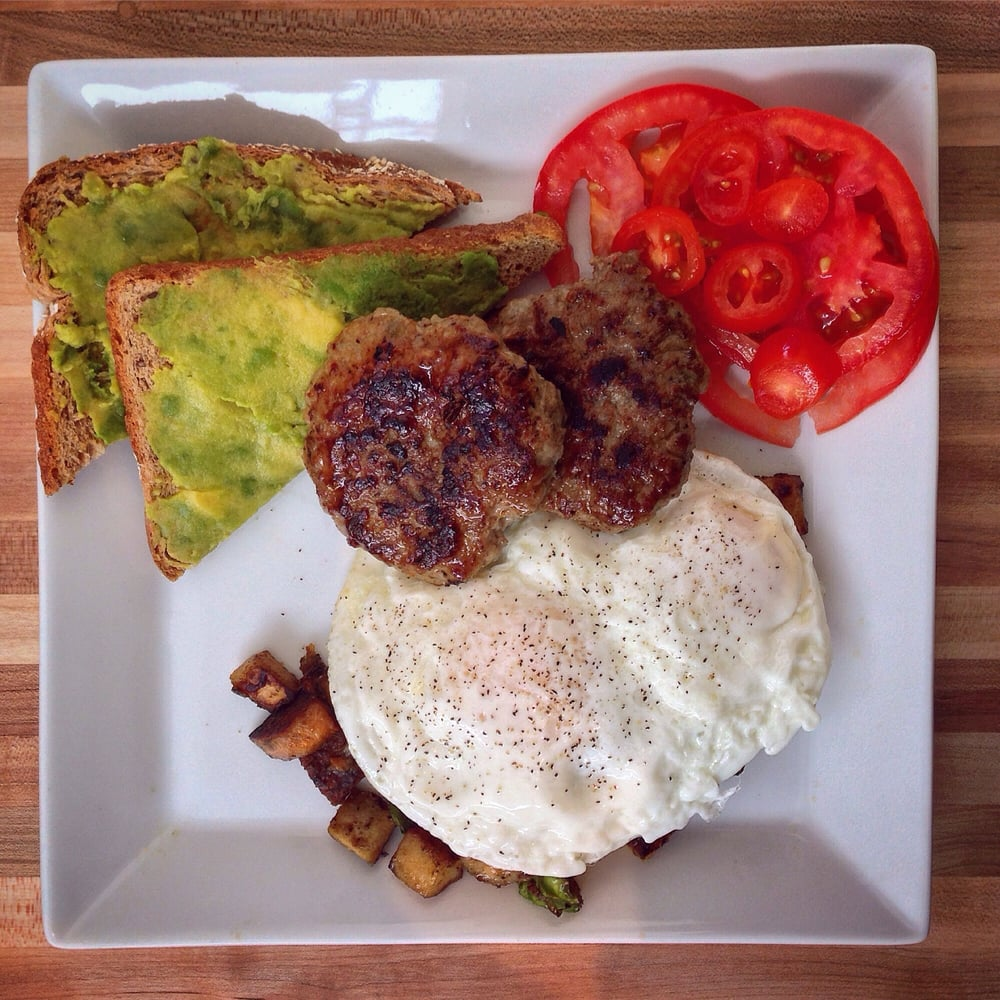 Pulp Lifestyle Kitchen - Salt Lake City, UT, United States. Crowding the Plate- cage-free eggs, smashed avocado toast, house-made turkey sausage, tomato slices, PULP hash