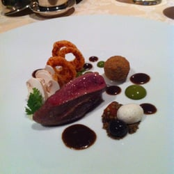Pigeon, olive sauce, onion rings,…