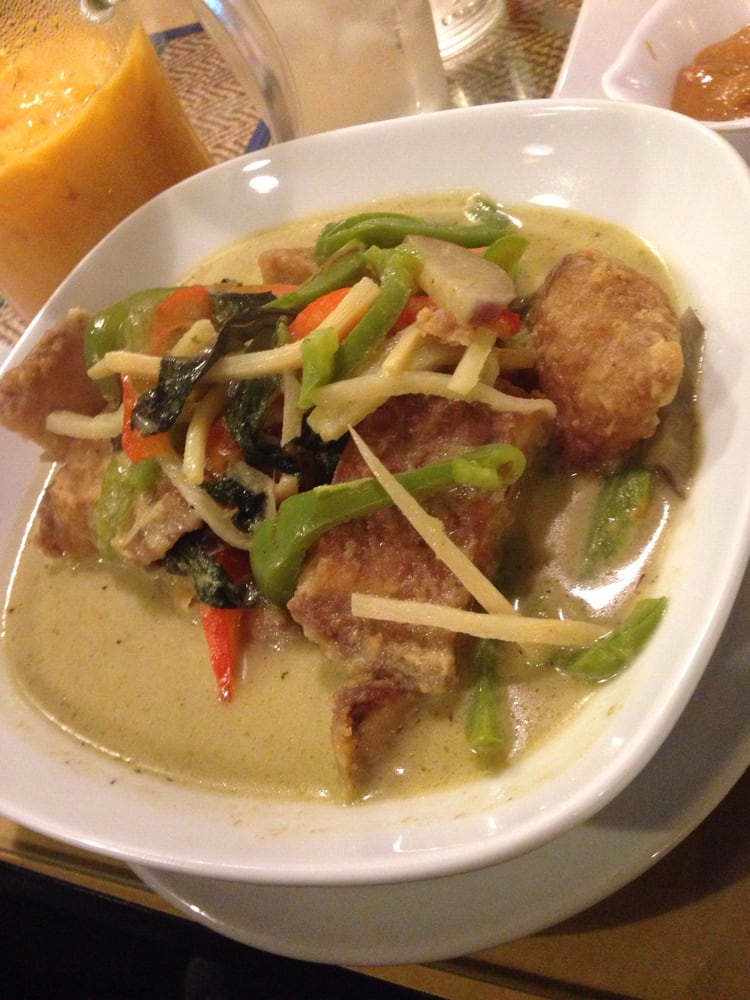 Tilapia in green curry! Really good highly recommend. It ...