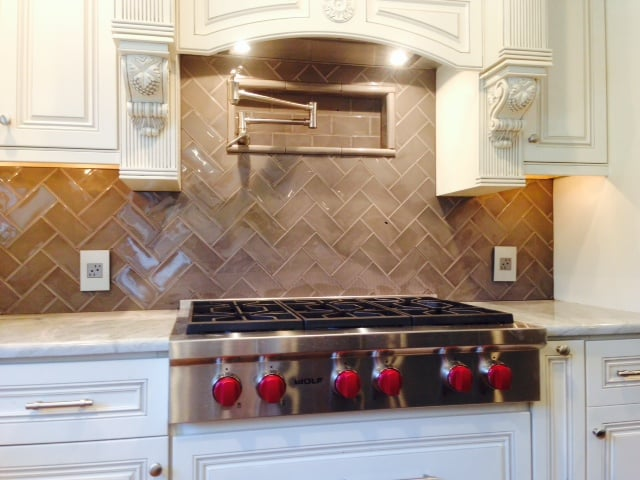 herringbone backsplash with onyx countertops yelp