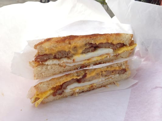 Breakfast sandwich - sausage patties, cheese and egg on sourdough ...
