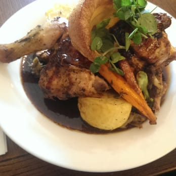 Half chicken Sunday roast with duck fat roast potatoes, parsnips, carrots and broccoli