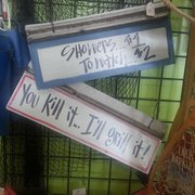 Parcell's Deli  Grille  Bakery - Benton, KY, États-Unis. Couple of cutesy signs available for purchase