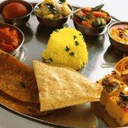 "Thali - the thali is a stainless steel platter with little bowls (""katoris"") consisting of a wide variety of different dishes"