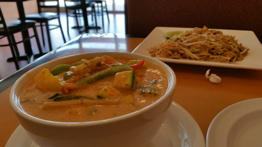 Red curry and in the corner is pad thai awesome flavors for Amazing thai cuisine