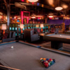 The Billiards Room with Three Pool Tables