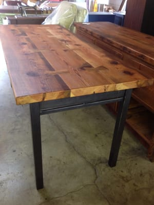 Custom built farm table from reclaimed wood and metal